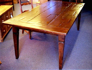 """#21 Maple dining table with breadboard ends and a groove cut in each tapered leg. Finish: Distressed, stained medium brown and a satin lacquer 84""""l x 42""""w x 30""""h"""