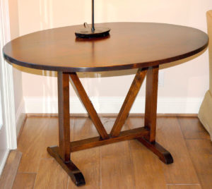 "#253 Oval table made of maple. Finish: Light distress with stain and satin top coat 46""L x 33""W x 28""H  Top is 1"" thick"