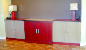 "#282 Maple buffet with the middle section able to pullout (on hidden wheels) to serve as a mobile bar.  The middle section has pocket doors for full access. 120""l x 24""d x 42""h Finish:  Red stain and tan stain with black accent on the edge, satin lacquer."