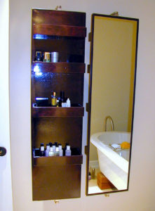 #290 Pair of Swivel Mirrors for the bathroom.  Stainless steel wall mounting hardware that holds the mirrors in place and allows them to swivel.  Mahogany shelves mounted on the reverse side of the mirror for storing bottles.