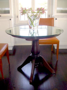 """#356 Maple pedestal table with glass on wooden top.  Turned pedestal with four graceful legs. 36"""" diameter x 30""""h Finish: Mahogany stain with satin lacquer finish"""