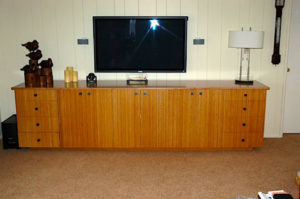 "#379 Bamboo media cabinet featuring 8 drawers and 3 large storage units. Finish: Clear satin top coat 10'l x 22""d x 28""h"