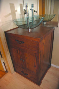 "#381 Asian inspired Oak bathroom vanity. The vanity has a Stain and semi-gloss top coat. 22""L x 19""D x 32"""