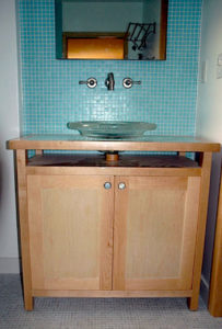 #383 Maple Bathroom Vanity.  Two flat panel doors open to reveal an adjustable shelf. Finish: clear stain lacquer