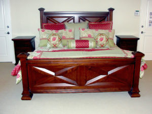 #441 Maple Bed This dramatic bed frame has hand crafted panels, finials and posts.  Nightstands featuring 3 drawers are a beautiful compliment to the outstanding set. The finish is a medium brown stain and satin lacquer.