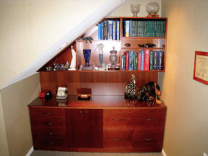 #424 Office breakfront made of maple and fitted into a slanted ceiling space. Finish:  Stain and satin lacquer