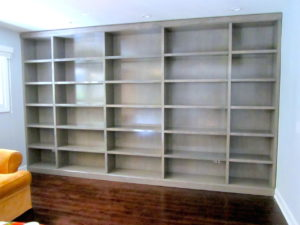 #2004 Maple Bookcase.  Floor to ceiling and wall to wall.  Features adjustable shelves throughout