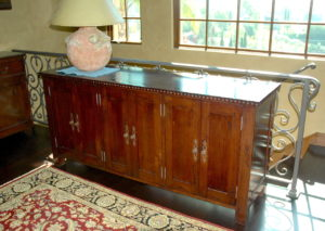 #2010  Maple cabinet houses a telescoping TV and the audio/video equipment.  This piece can be used against a wall or as a room divider.  The maple is distressed with a medium brown stain and satin lacquer