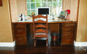#1999 Home desk made of maple.  Full extensions drawers and a panel to hind the electrical cords behind the doors Finish:  Stain with satin lacquer