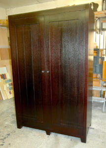 """#367 Mahogany armoire with pocket doors, pull-out swivel for TV and a shelf for DVD/cable box above TV.  The doors have three equal planks. Finish: Brown/Black transparent stain with satin top coat 84""""h x 54""""w x 24""""d"""