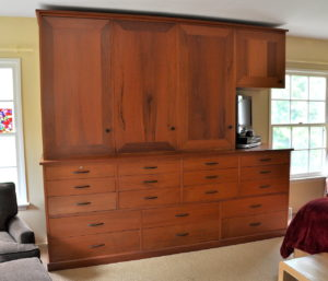 "#295 Mahogany Bedroom dresser.  18 drawers with efficient storage in mind.  Upper cabinet has adjustable shelves and a cut out for a TV. 106""L x 84""h x 25""d (bottom) 20""d (top) Finish:  clear satin lacquer"