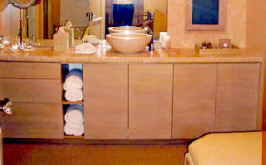 #315 Oak Bathroom vanity featuring 4 touch latch doors with pull out shelves, a space for rolled towels and 4 doors.