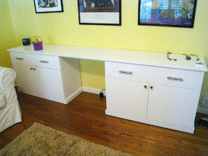 #425 Home desk made of maple.  Full extensions drawers and adjustable shelves behind the doors Finish:  White satin paint