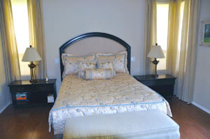 #434 Maple hand carved headboard frame with upholstery. Finish:  Stain and satin lacquer
