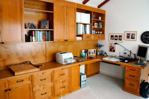 #377 Home office with two desks at opposite ends Finish: Maple with cherry stain and satin lacquer and laminate countertop
